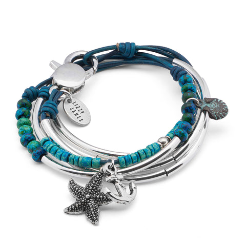Fiona with Starfish Anchor Shell Beach Charm Trio in natural blue leather