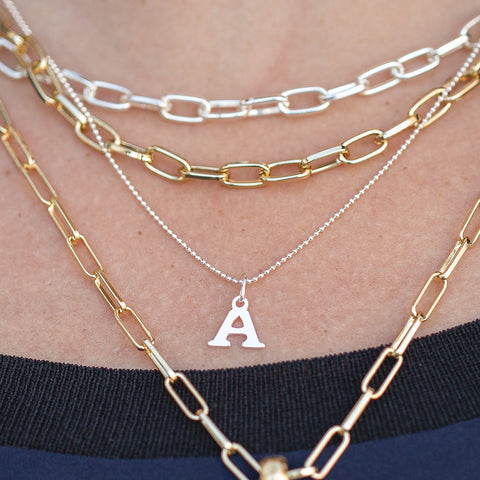Sterling silver initial necklace, shown with Letter A attached,  layered with the silver and gold Kinsley necklaces
