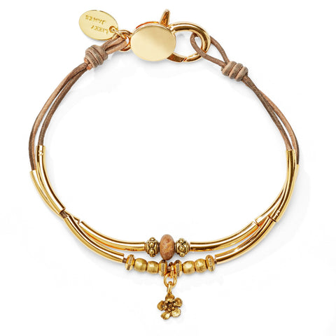 Lauren Anklet in Goldplate with Petite Flower Charm shown in natural brown gray leather