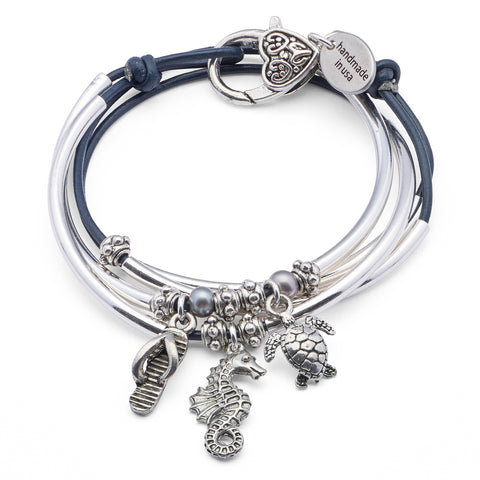 Mini Charmer wrap bracelet in Gloss Navy leather with Flip Flop Sandal Seahorse Turtle charms, comes as shown