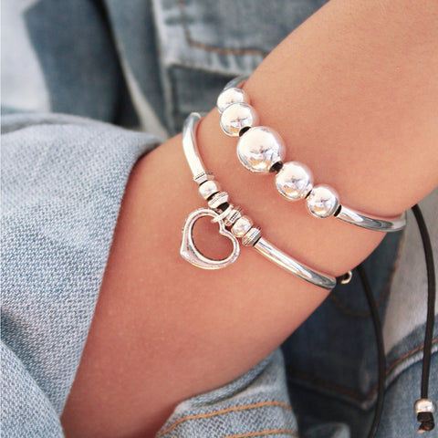 stacked Joy Bracelet Set features the Wisdom and Sweetheart bracelets from our Joy Collection- sold as 1 set