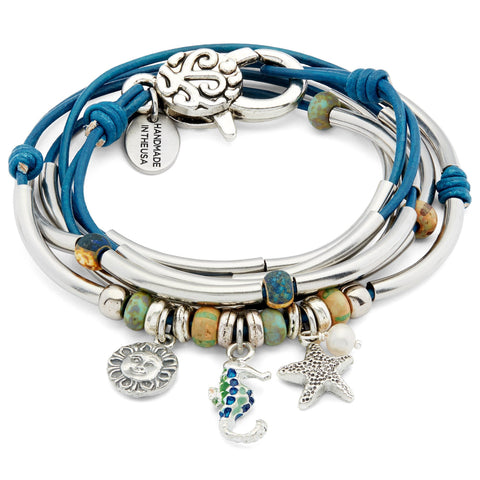 Mandee with Seahorse Sun & Starfish Charms Trio shown in natural true blue leather