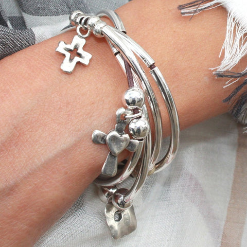 Mini Addie Cross charms trio leather wrap bracelet, comes as shown. Designed to be worn as a bracelet only.