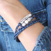 Mini Nina bracelet shown in natural blue leather