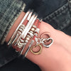 open heart charm trio shown on Double Love leather wrap bracelet
