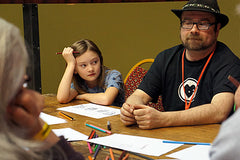 Kate in a lesson with Gareth K Vile, at Sunderland Comicon