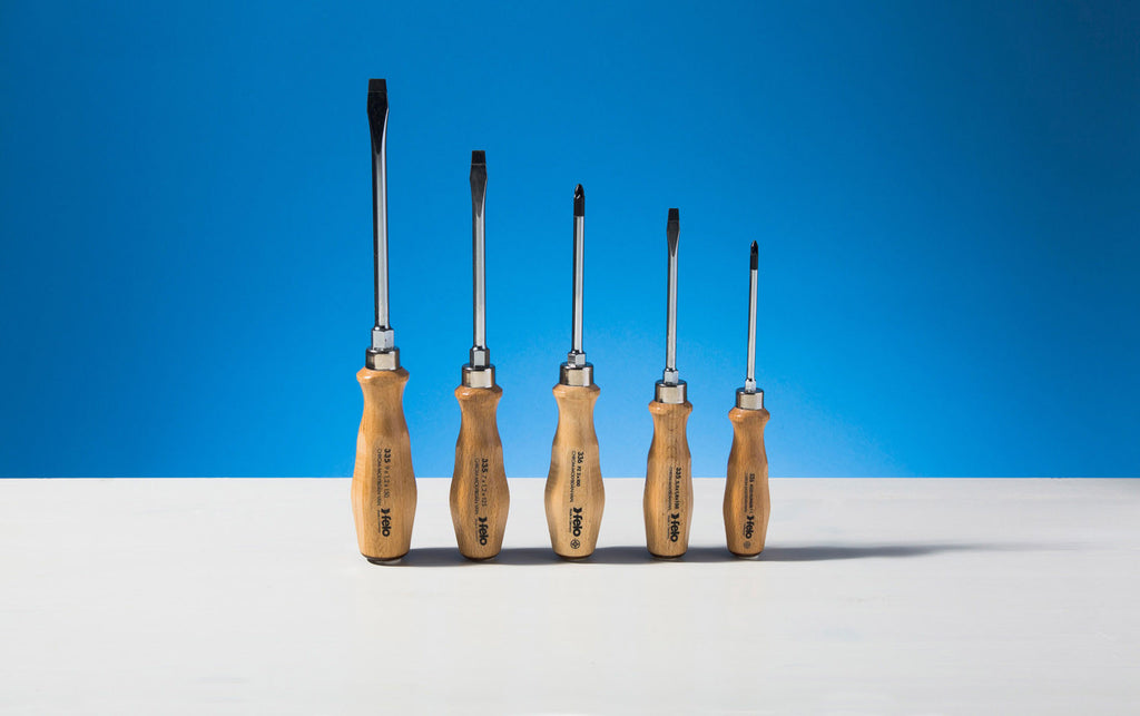 5 Piece wood handled screwdriver set with leather tips.
