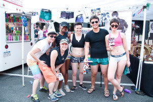Play Out does Pride. Sylvie in rainbow shorts, Abby in orange shorts, bottom left. Photo by Lisa Iancin, aLIas Photography