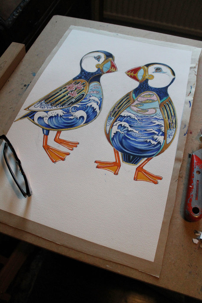 Puffins with seascape interior painting in progress
