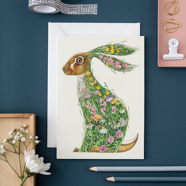 Hare in a meadow greetings card