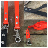 Glossy bright orange dual handle leash