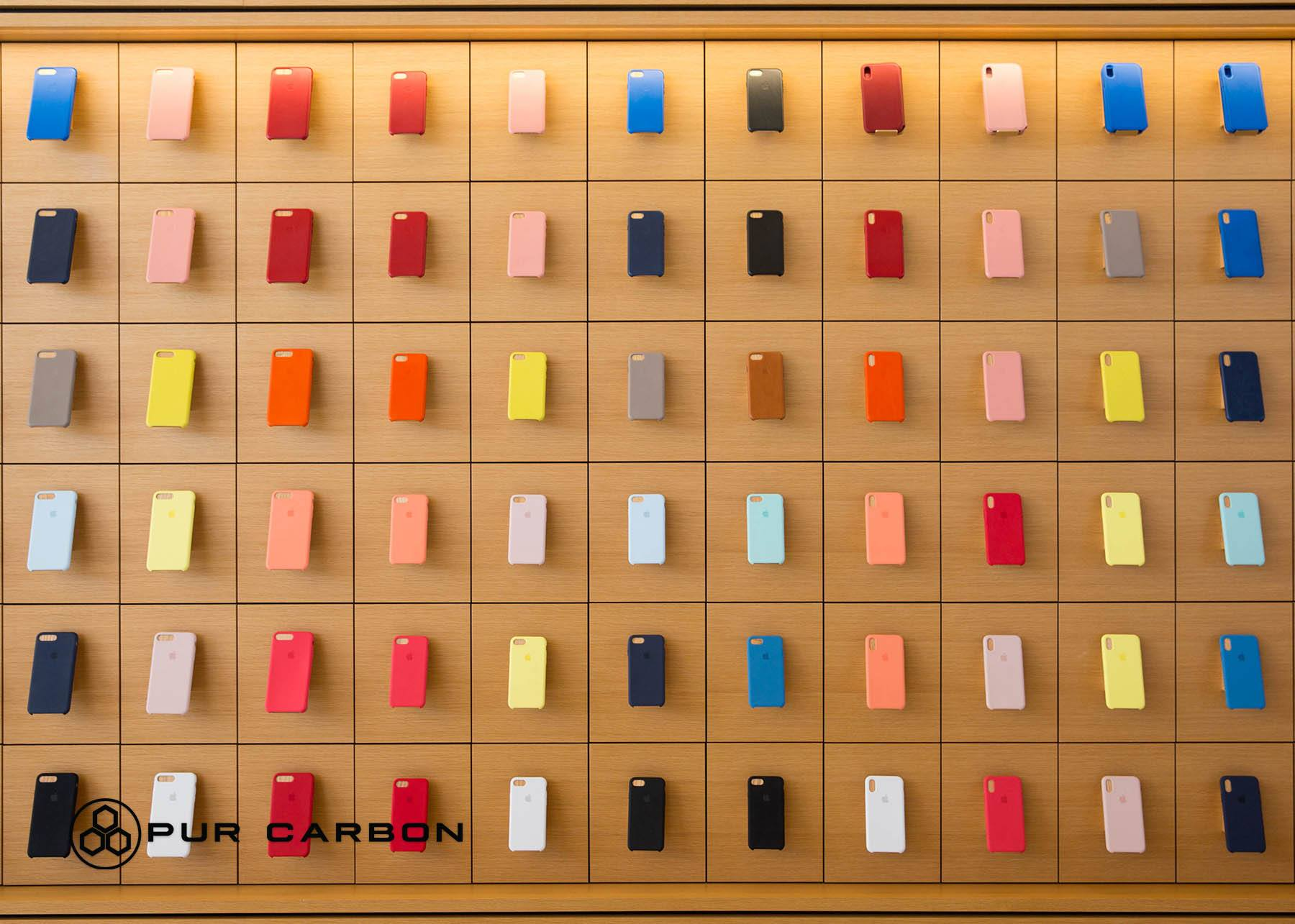iPhone cases displayed on a wall for customers to choose from