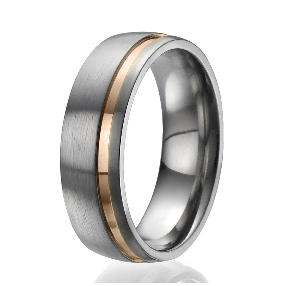 7mm domed Titanium Ring with a stylish rose gold plated stripe