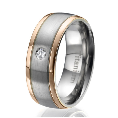 8mm Titanium Ring with 2 stylish rose gold plated stripes on the sides and a round zirconia