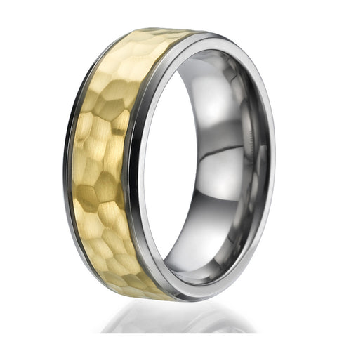 8mm Titanium Ring with a stylish hammered stripe plated with yellow gold