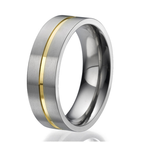 7mm Flat design Titanium Ring with an engraved stripe plated with yellow gold