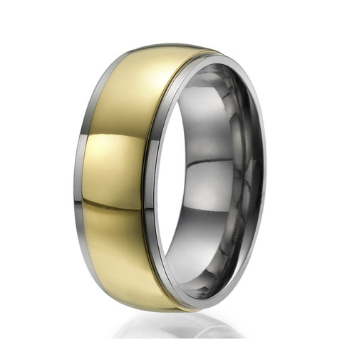8mm Titanium Ring with a centered wide stripe plated with yellow gold