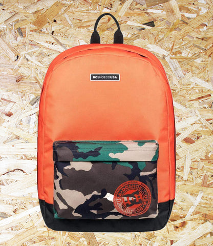DC, Backstack 18.5L Backpack, Orange/Camo,  Large main compartment, External pocket with organiser, Internal padded and elevated laptop sleeve, Padded rear panel, Woven label on shoulder strap