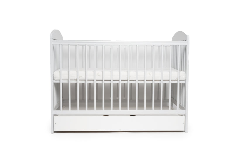 Tomi 7 baby cot with mattress and drawer closed