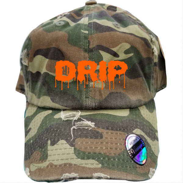 """DRIP"" DISTRESSED DAD HAT - GREEN CAMO/ORANGE"