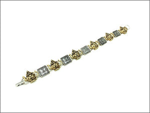 Two tone irish tea time bracelet with clasp closure