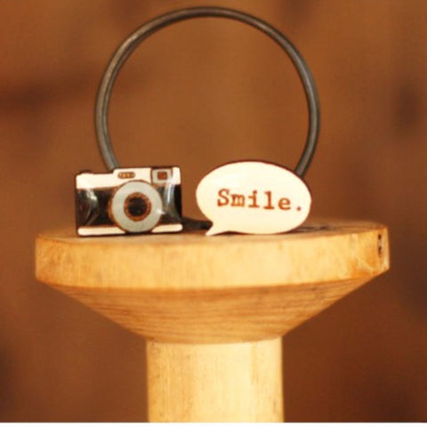 bok bok b'gerk earrings 'camera smile'