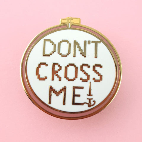 jubly-umph enamel pin 'don't cross me cross stitch'