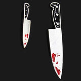 sugar earrings 'asymmetrical knife studs'