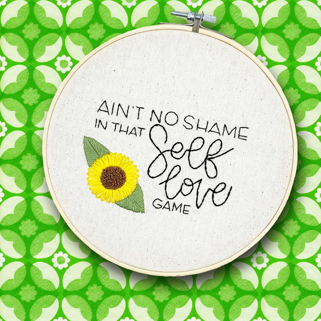 handmade by k embroidery hoop 'ain't no shame in self love'