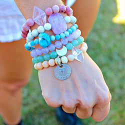 multi colored beaded bracelets on wrist
