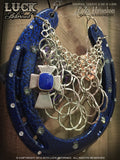 Cobalt Faith Lucky Horseshoe is accented with sparkling white and silver Swarovski crystals.