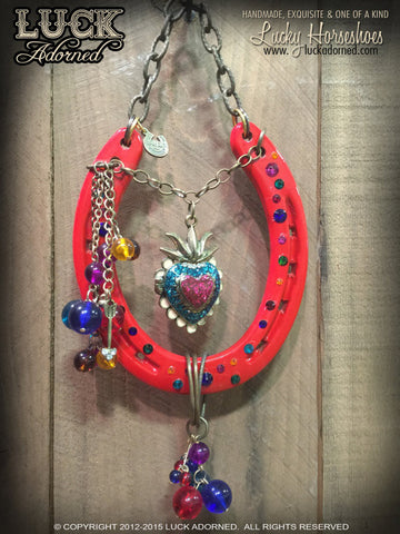 SACRED RIO Luck Adorned lucky Horseshoe is a striking red horseshoe that just screams fun & festive! It has a gem of a centerpiece that is actually a sacred heart photo locket.