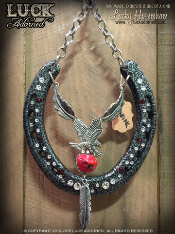 SOARING Luck Adorned Lucky Horseshoe is done on that super cool, metallic, gun metal grey with a hammered texture and has a cool eagle above a simulated coral stone with silver metal chain and feather accents.