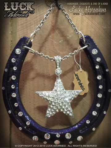 STARLIGHT Luck Adorned Lucky Horseshoe is a metallic purple candy horseshoe with that hammered finish we just love. It has a big, shiny star in the center and big, shimmering, white diamond Swarovski crystals-all hanging from a bold, silver chain.