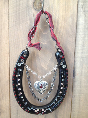 Luck Adorned Lucky Heart Lucky Horseshoe Lucky Heart is a shiny, gloss black shoe that features a vintage heart pendant, antique chains and lots of sparkly Swarovski Crystals in ruby and white diamond.