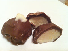 Buttercream Truffles made with fresh butter and dipped in milk chocolate or dark chocolate, your choice