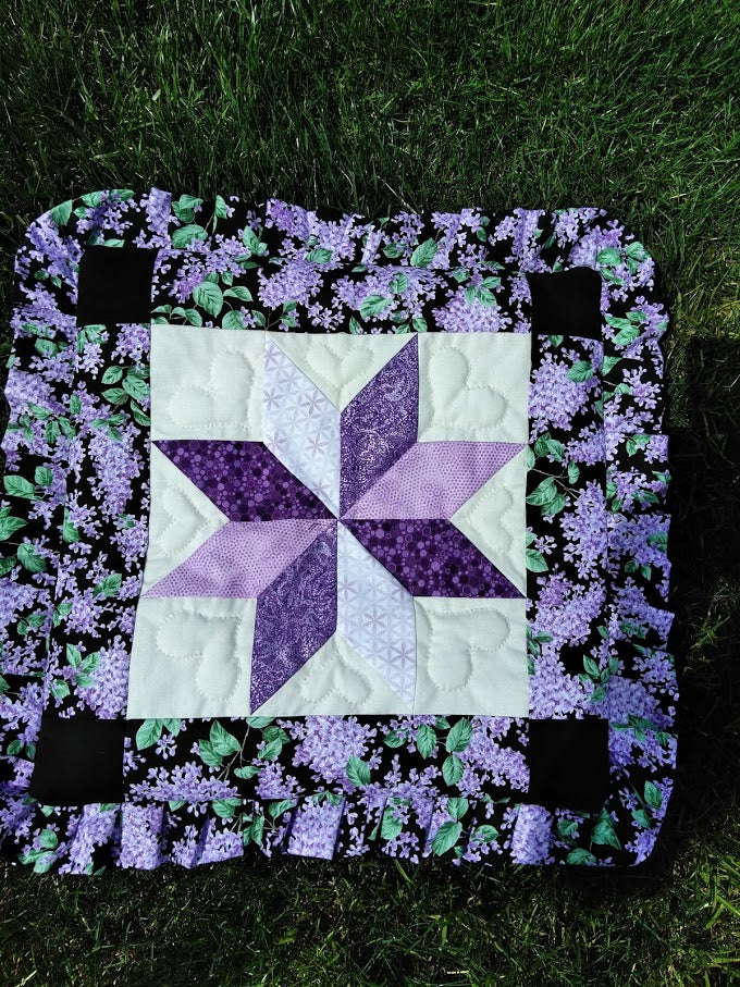 purple and green pillow cover.