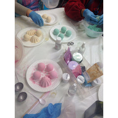 guests making bath treats at bath bomb making workshop