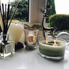 Lubylu 3 wick soy wax candle on a window sill lit