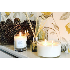 Lubylu 3 wick soy wax candle in a dining room lit