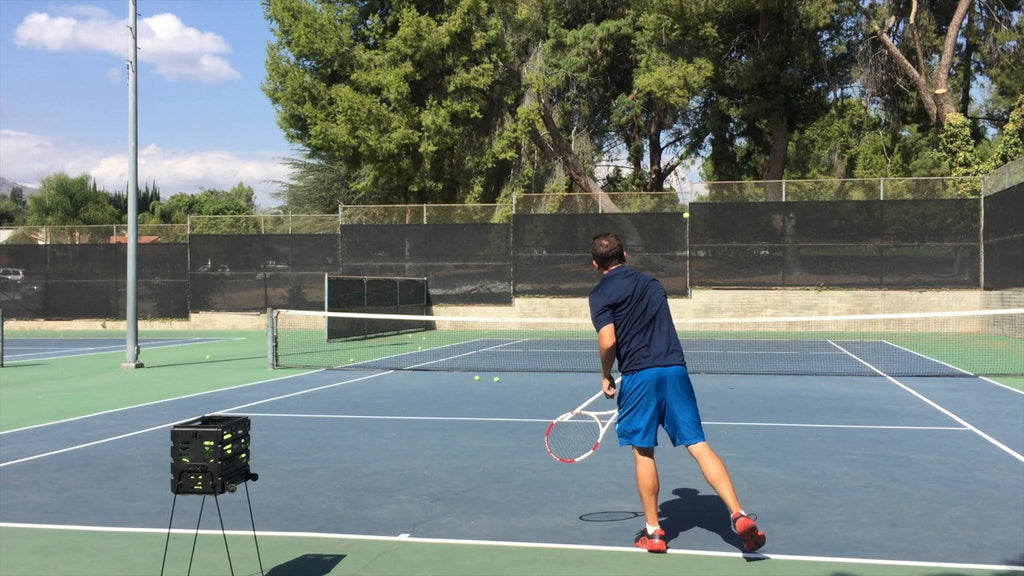 The Dicer: How to produce a sliding slice serve that can open up the court or jam your opponent