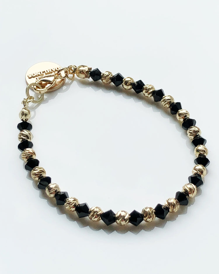 Swarovski crystal and 14K gold plated beads bracelet in black and gold