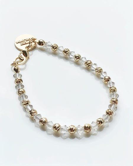 Swarovski crystals and 14K gold plated beads bracelet in white and gold
