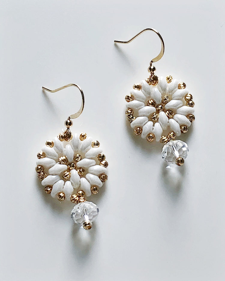 Mini wheel of fortune earrings in white