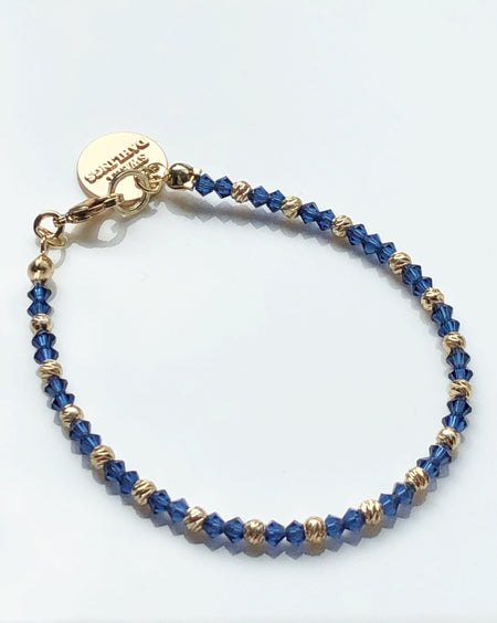 Swarovski crystals and 14K gold plated beads bracelet in blue and gold