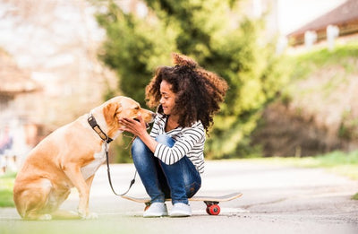 6 Benefits of Children Growing Up with a Dog