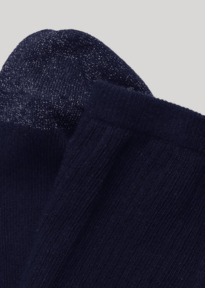 Our Malene ribbed cotton sock in Midnight with glitter in heel and toes is made of soft GOTS certified premium organic cotton yarn.