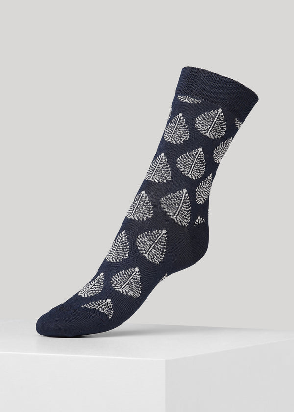 Super soft and fine knitted cotton socks with birch leaf pattern and Dear Denier logo on the sole.