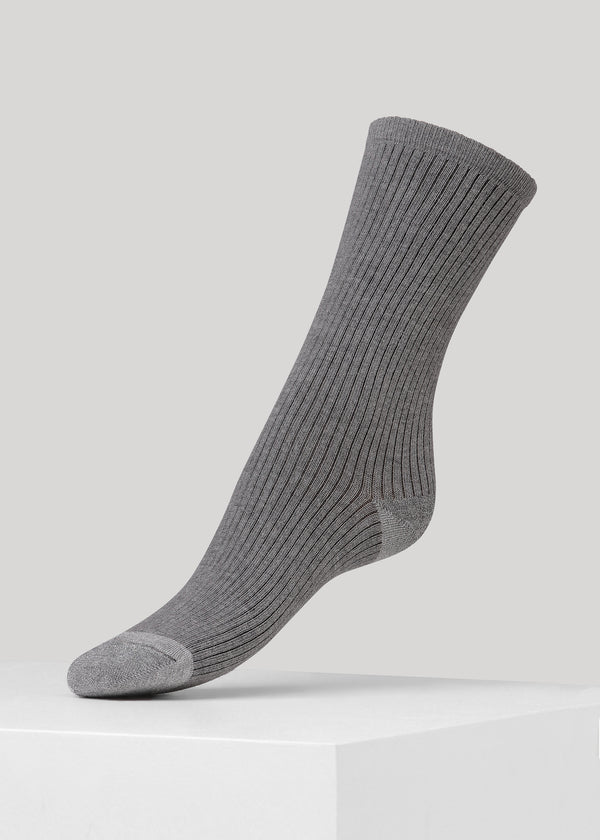 Our Malene ribbed cotton sock in Grey with glitter in heel and toes is made of soft GOTS certified premium organic cotton yarn.