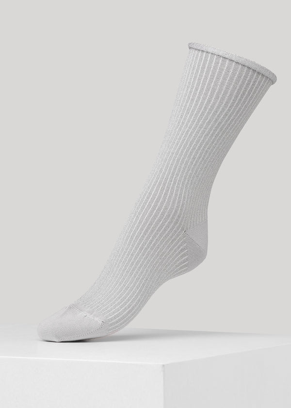 Our Malene Rib Glitter sock is premium full glitter ribbed socks in Silver with elegant roll-top. They are made in premium Lenzing Viscose® yarn, with 180 needles fine gauge.